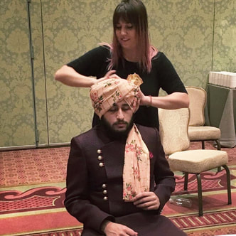 Turban tying for guests at indian wedding