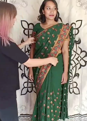 Saree draping on wedding guest for indian wedding